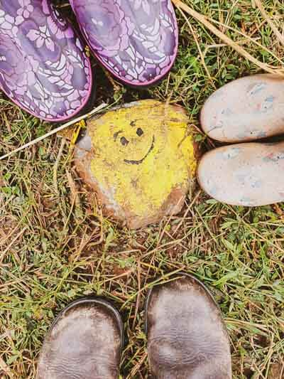 Yellow painted smiley rock